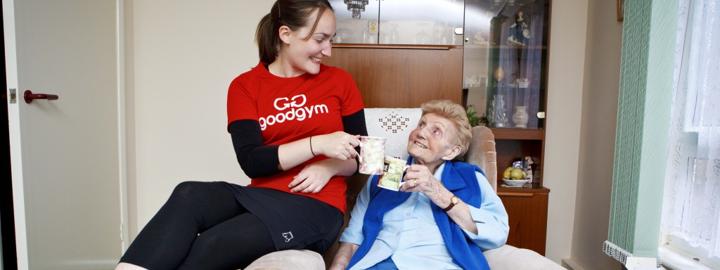 A GoodGym runner sharing a cup of tea with an older person in Hackney