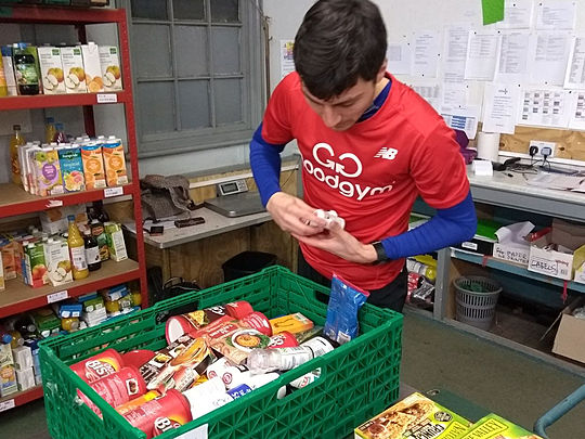 Help to sort essential food donations or drop off donations of your own