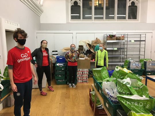 Helping pack and deliver food parcels.